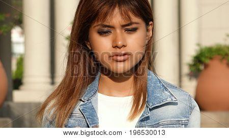 Hopeless Peruvian Teen Female Wearing a Denim Jacket