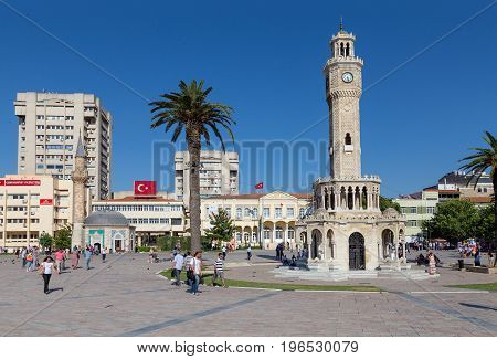 IZMIR, TURKEY - JUNE 21: The famous Konak square on June 21, 2013 in Izmir, Turkey. At the center of the square is the Izmir Clock Tower, the most recognized landmark of the city.