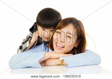 Asian mother and her son indoor portrait