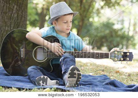 He Really Enjoys While Playing Guitar