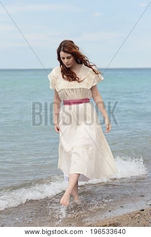 portrait of vintage woman playing on the beach