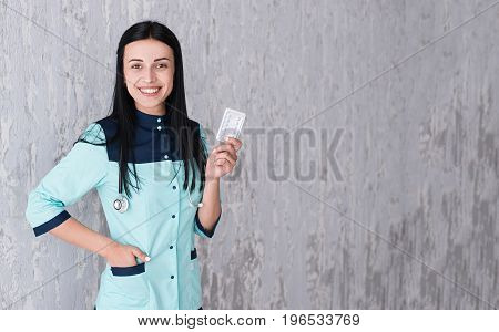 Portrait of beautiful young doctor or nurse smiling