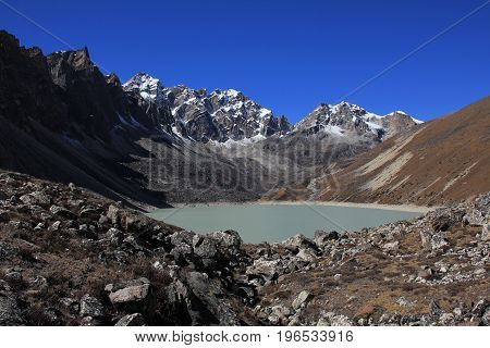 Autumn scene in the Everest National Park Nepal. Lake and mountains in the Gokyo valley.