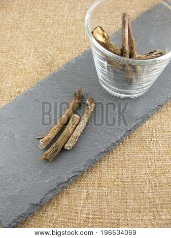 Dried liquorice pieces on a slate plate