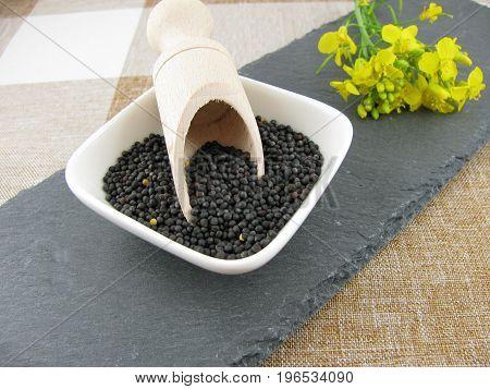 Fresh black rapeseed on a slate plate