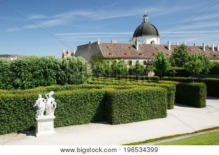 Fragment Beautiful Garden Of The Lower Belvedere Palace And View Of The Dome Of The Church. Vienna
