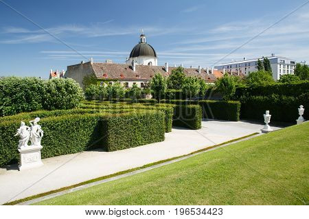 Green Labyrinth In The Garden Of The Belvedere Lower Palace And A View Of The Dome Of The Church. Vi