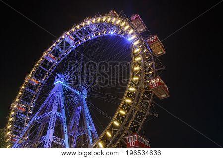 Lighting Ferris Wheel At Night In Famous Prater Theme Amusement Park, Vienna