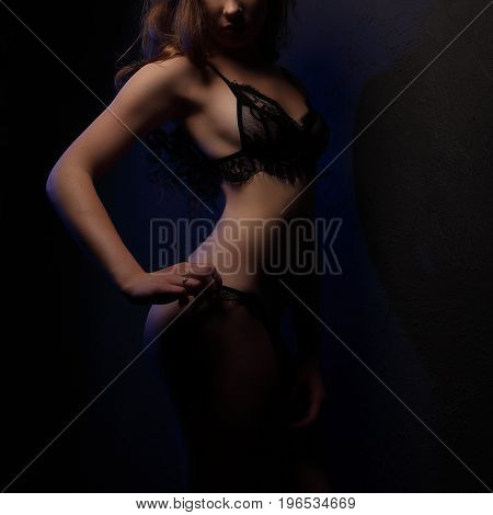 Sexy Young Beautiful Woman With Curls In Sensual Black Lingerie, Lighted With Blue In Studio, Visibl