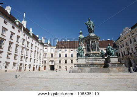 View On The Inner Yard Of Hofburg Palace, Vienna, Austria. Monument Of Kaiser Franz In The Middle Of