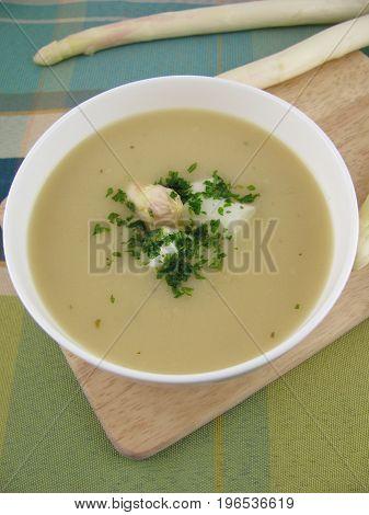 Fresh asparagus cream soup in a bowl