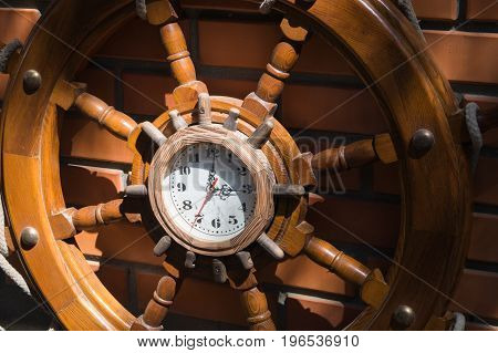 Decorative ship wooden steering wheel with a clock