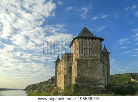 The castle near the river at dawn