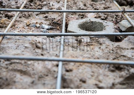 stake in the hole on the ground with steel structure.