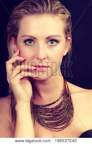 Elegance feminity lady beauty concept. Portrait of beautiful dreaming elegant woman with big necklace