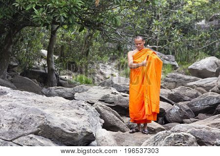 Monk Visiting Kep Waterfall