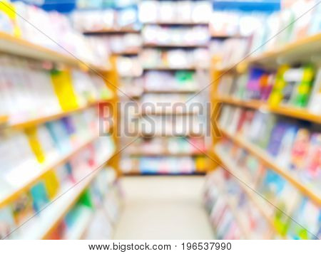 Blurred abstract background of book on bookshelves in bookstore or library with literature.