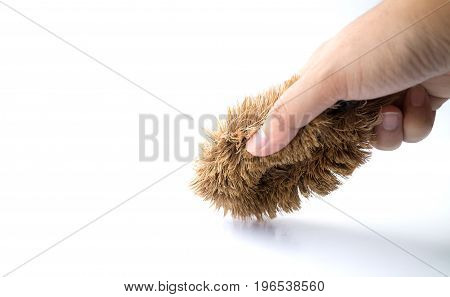 human hand holding a cleaning brush isolated on white