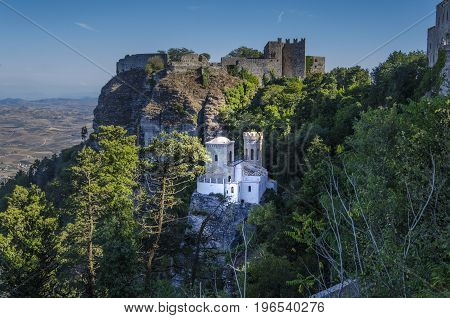 Above the old castle as close-up the tower pepoli and in the distance the plains of the island of Sicily from the ancient city of Erice