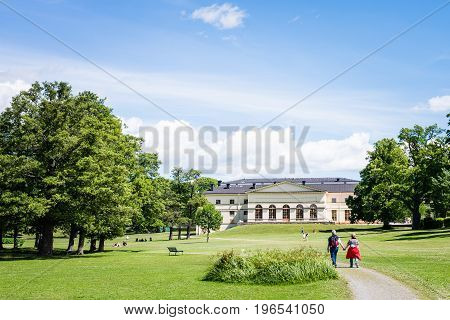 STOCKHOLM SWEDEN - JULY 5 2017: View over Drottningholm Palace and park on a sunny summer day. Home residence of Swedish royal family. Famous landmark and tourist destination in Stockholm Sweden
