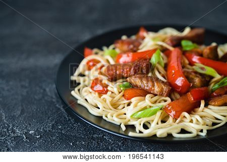 Szechuan Stir Fried Spicy Pork With Red Pepper And Green Onion. Chinese Food Or Asian Cuisine Concep