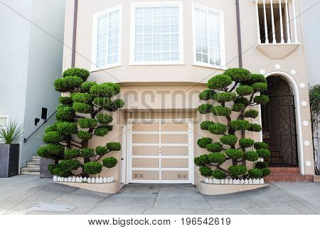 Garage entrance with nicely trimmed trees around