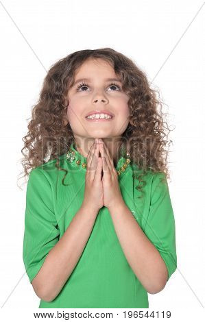 Cute little girl praying isolated on white background