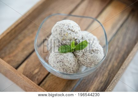 Home made poppy seed lemon ice cream in a bowl