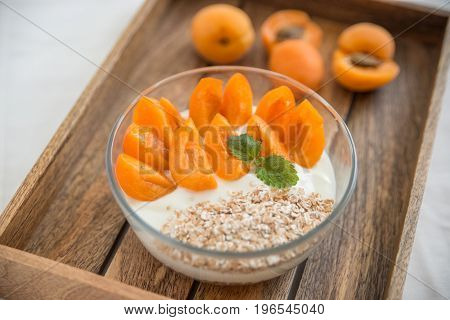 yogurt with apricots and granola for breakfast