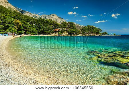 Fantastic beautiful summer holiday place with Adriatic Sea Biokovo mountains and wonderful bay Brela beach Makarska Dalmatia Croatia Europe