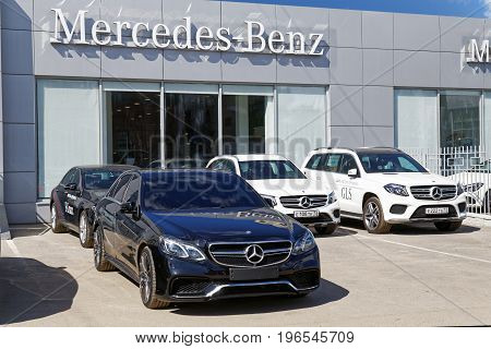 Ulyanovsk Russia - July 22 2017: Building of Mercedes-Benz car selling and service center with Mercedes sign and the cars in front of it.