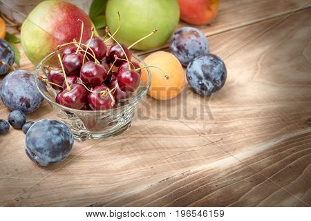 Sour cherry (cherry) and another seasonal fruit on table - healthy food