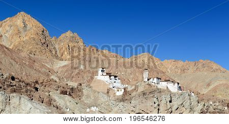 View on the beautifully located Buddhist monastery in the Basgo village in the background one can see the mountains Ladakh is admiring the beautiful Karakorum panorama