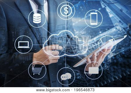 Double Exposure Of Professional Businessman Connecting Cloud Technology Network And Devices On Hand