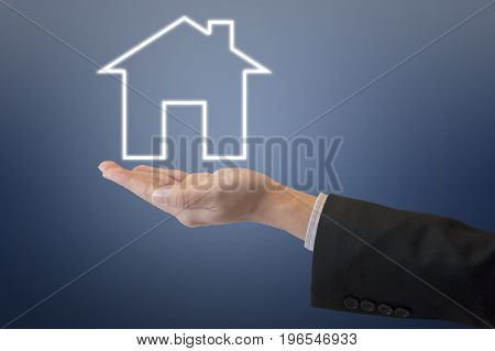 Professional Business Man Holding Out Under Digital House Icon With Clear Blue Tone Background For H