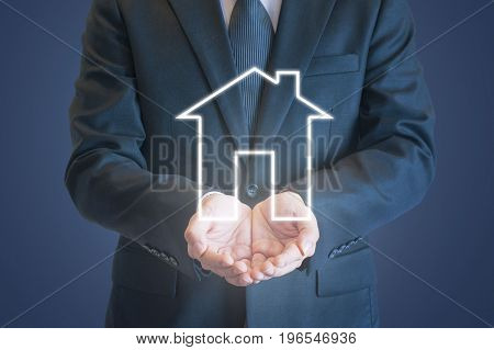 Business Man Holding Out Hands Under Digital House Icon With Clear Background For Home Purchasing, R