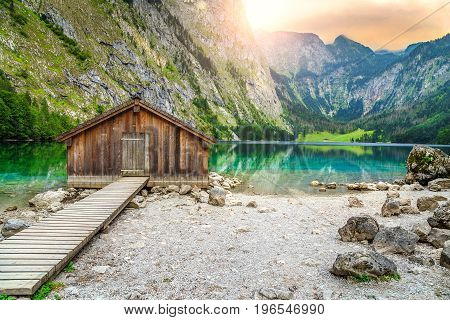 Beautiful landscape with wooden boathouse on the mountain lake in Bavarian Alps Obersee Berchtesgaden Germany Europe