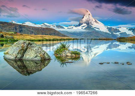 Fantastic sunrise panorama with Matterhorn and beautiful famous alpine lake Stellisee Valais region Switzerland Europe