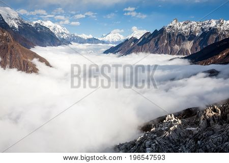 Manaslu valley covered with clouds on Manaslu circuit trek in Nepal