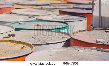 On the territory of the processing plant there are dirty barrels with the used oil
