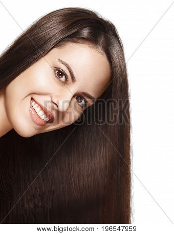 portrait of attractive smiling brunette woman with long hair isolated on white background