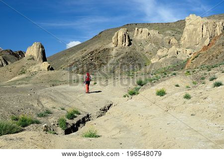 Tourist during expedition in the mountains Ladakh is admiring the beautiful Karakorum panorama