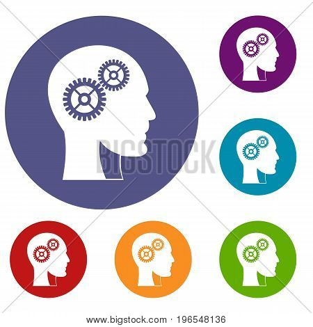 Gears in human head icons set in flat circle red, blue and green color for web
