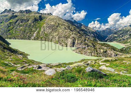 Wonderful nature landscapes with the dam on the Grimselpass Grimselsee lake near Interlaken touristic town Switzerland Europe