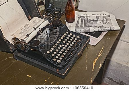 FAENZA, ITALY - NOVEMBER 2: old typewriter in reproduction of military camp office of world war 2 exposed during the town feast