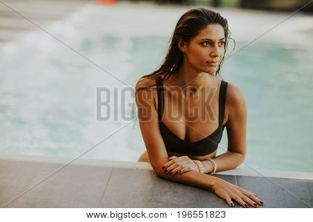 Pretty Young Woman Relaxcing On The Poolside