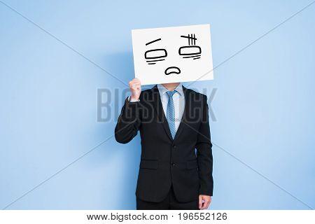businessman take tired billboard on the blue background