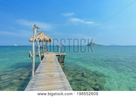 Long wooden bridge go to pavilion on the sea in beautiful tropical island Thailand