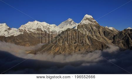High mountains Lobuche mount Everest and Cholatse seen from the Gokyo valley.