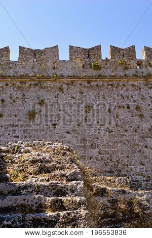 big ancient wall of old stone fortress for a background